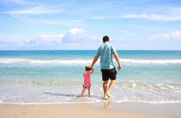 Father and daughter by the sea